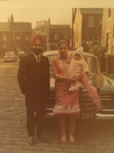Young Simran Kaur with her parents
